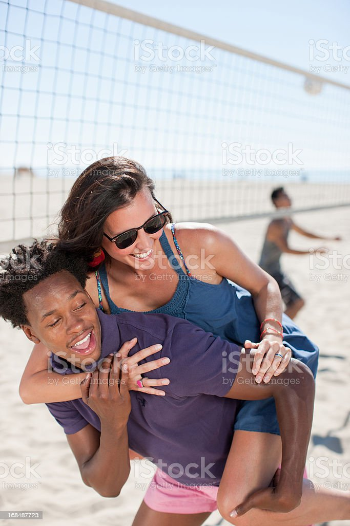 Couple playing together on beach  royalty-free stock photo