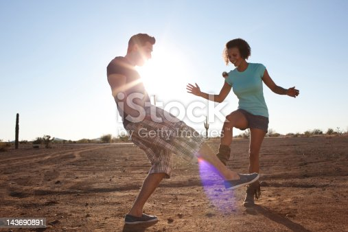 istock Couple playing with hackey sack outdoors 143690891
