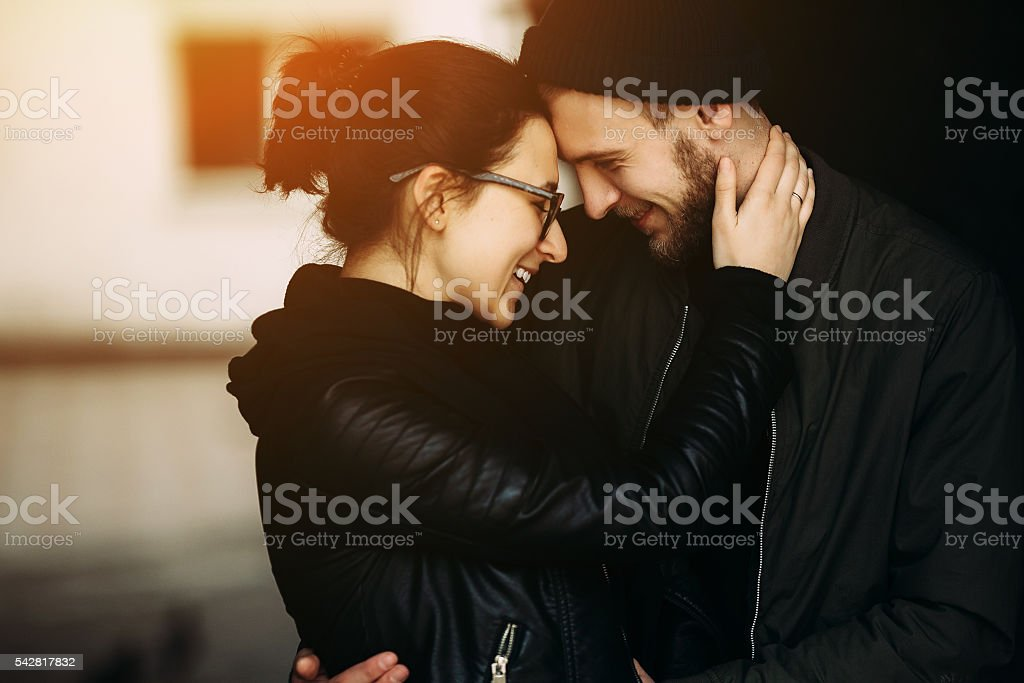 couple posing in backstreet stock photo
