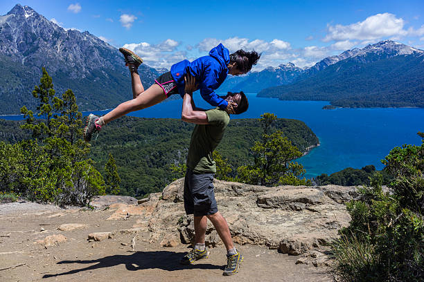Couple posing in San Carlos de Bariloche.  Patagonia, Argentina stock photo
