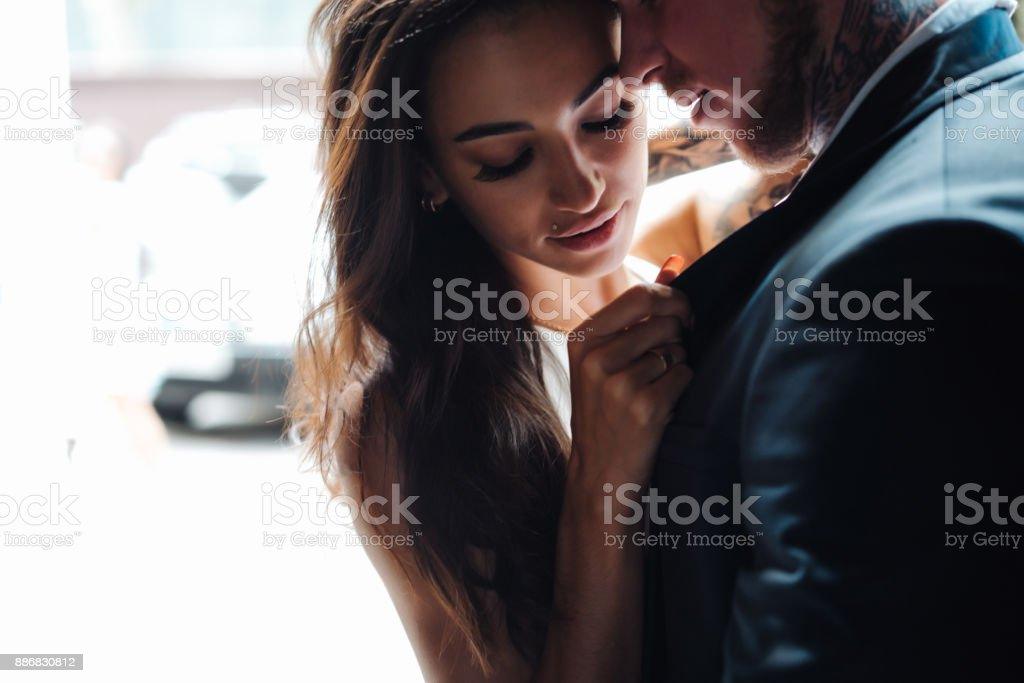 couple posing in the doorway stock photo