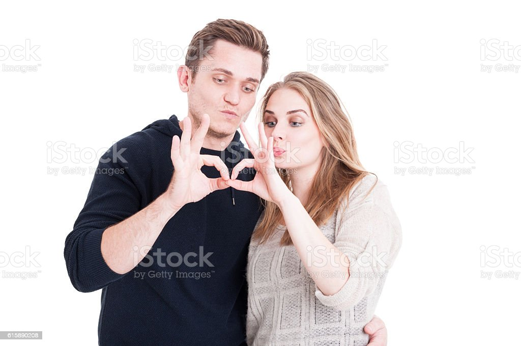 Couple posing playful and showing ok gesture stock photo