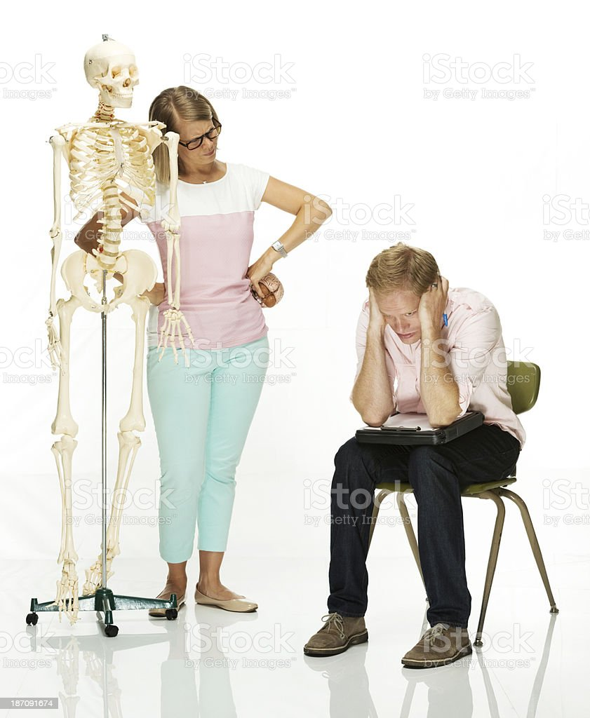 Couple posing with anatomical model royalty-free stock photo