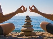 Couple practicing yoga on the beach. Zen. Calm and relax