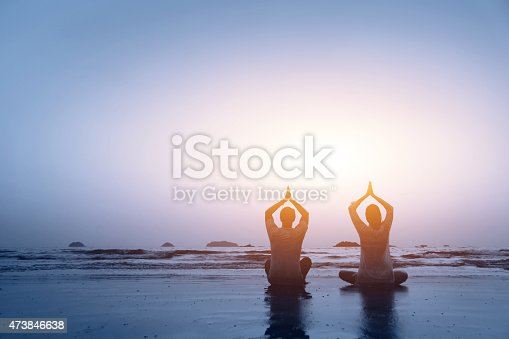 istock couple practicing yoga 473846638