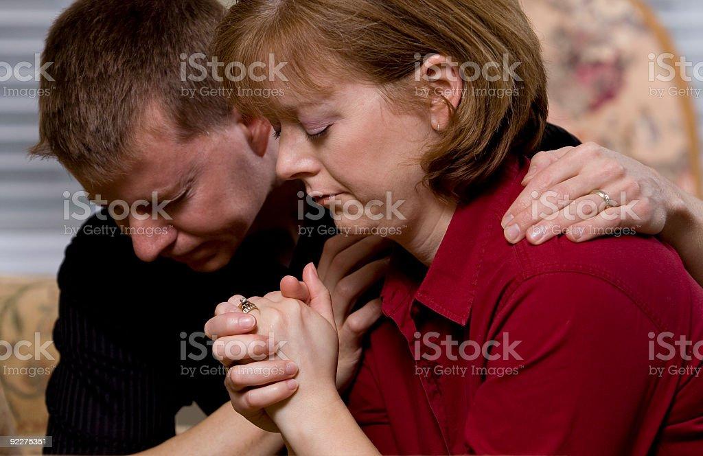 Couple praying together stock photo