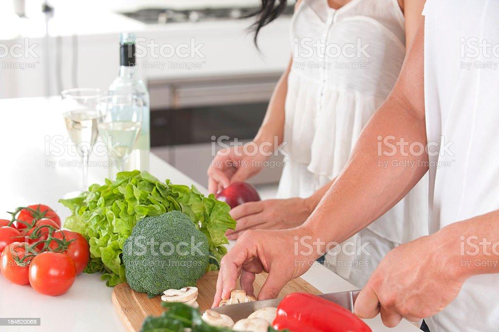 Couple preparing food royalty-free stock photo