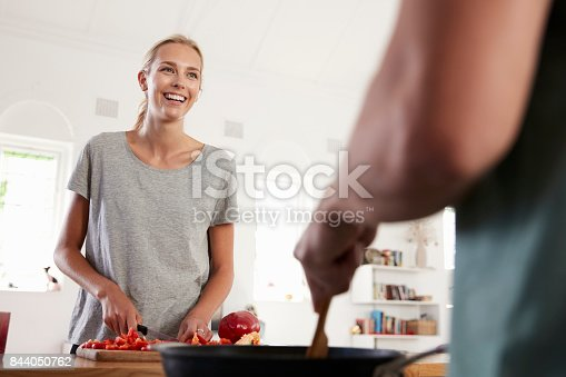 844050630 istock photo Couple Preparing Meal Together In Modern Kitchen 844050762