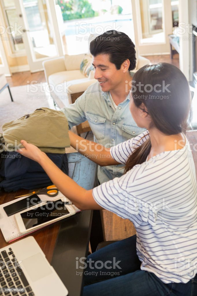 Couple process order for home clothing business stock photo