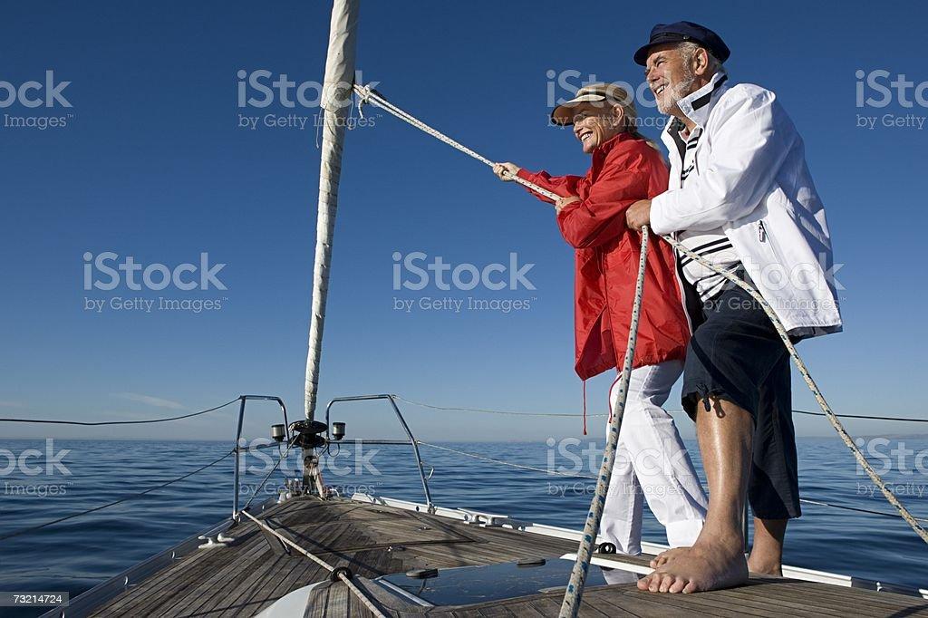 Couple pulling rope stock photo