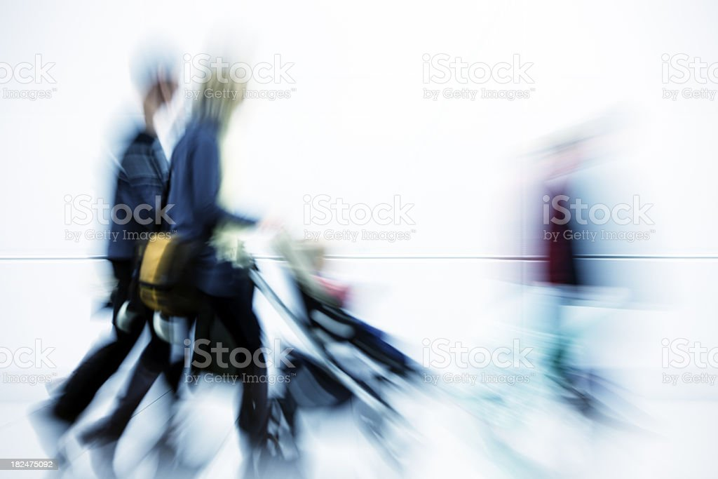 Couple Pushing Baby in Stroller, Motion Blur royalty-free stock photo