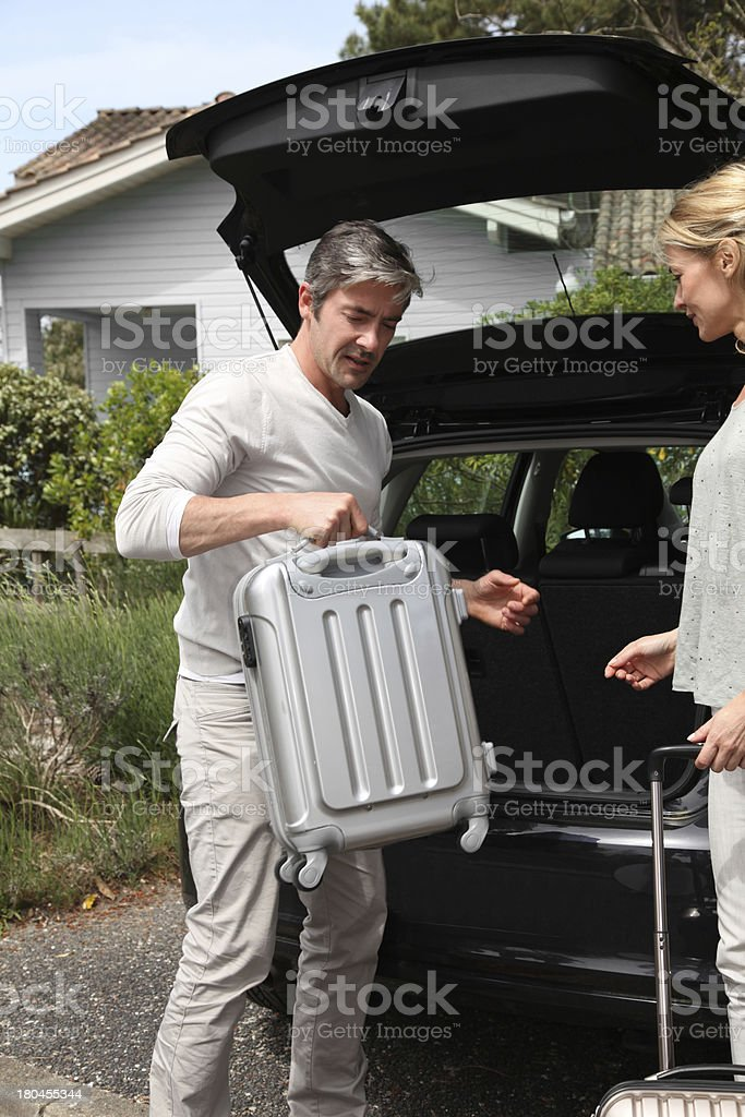 Couple putting luggages in car royalty-free stock photo