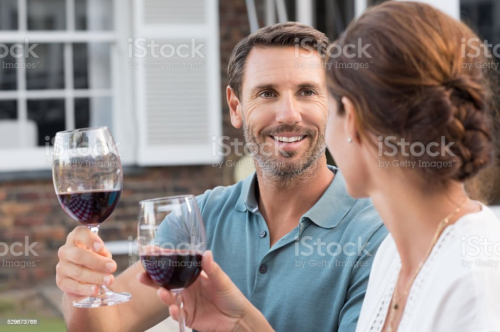Couple raising toast stock photo