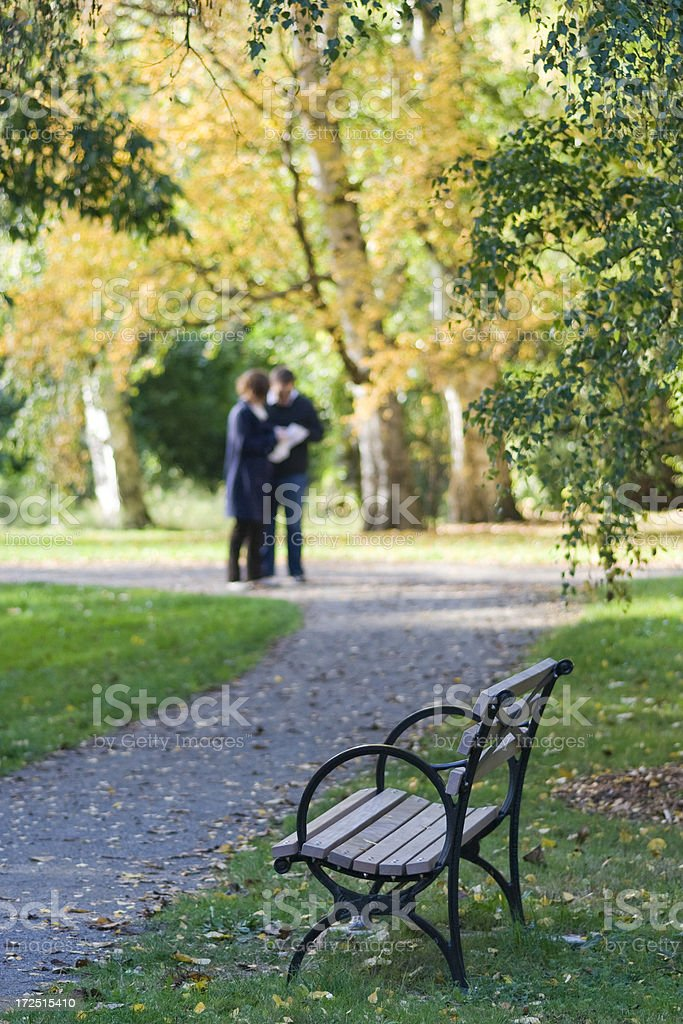 Couple read directions in park royalty-free stock photo