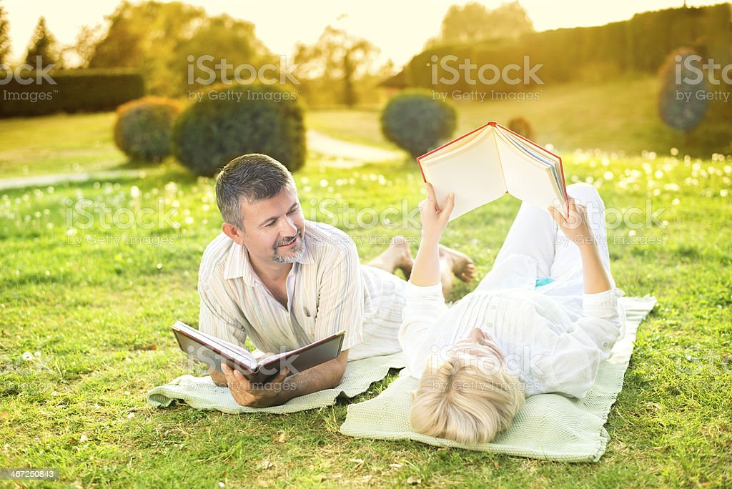 Couple reading a book royalty-free stock photo