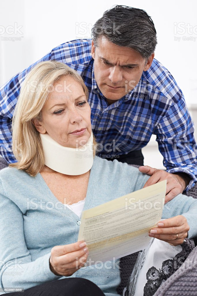 Couple Reading Letter About Wife's Injury stock photo