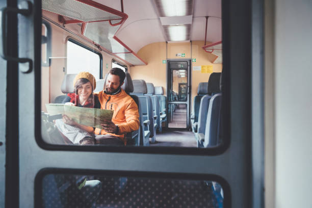 Couple reading map in the train stock photo