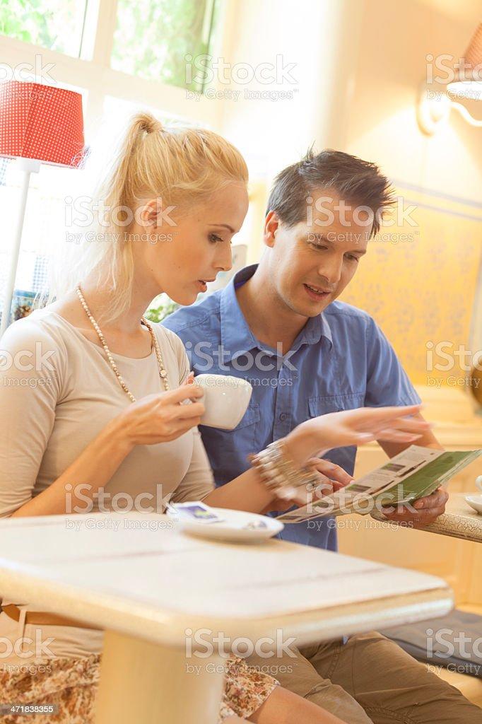 Couple reading menu at restaurant. royalty-free stock photo