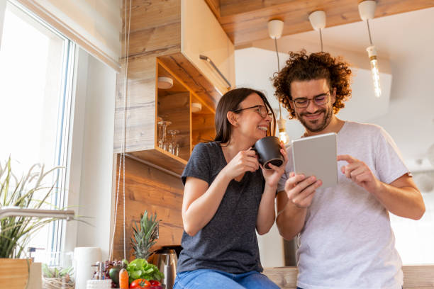 Couple reading news and drinking coffee stock photo