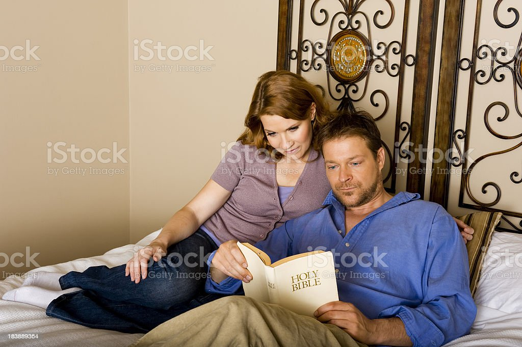 Couple reading the bible stock photo
