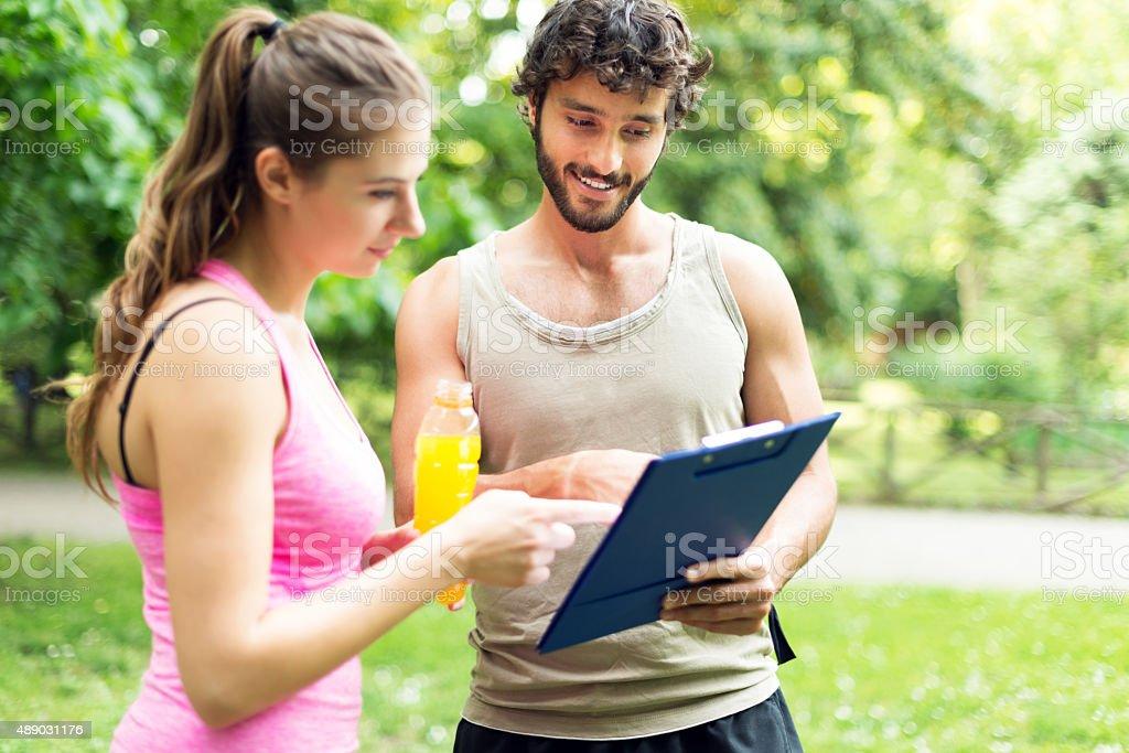 Couple reading their training program stock photo