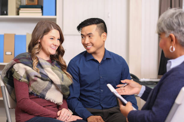 Couple receives counseling from mental health professional. stock photo