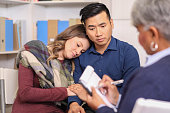 istock Couple receives counseling from mental health professional. 1148010528