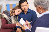 istock Couple receives counseling from mental health professional. 1164215236