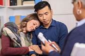istock Couple receives counseling from mental health professional. 1178175504