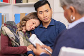 istock Couple receives counseling from mental health professional. 1178175600