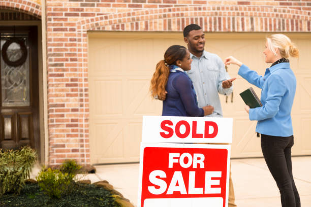 couple receives keys to first home real estate purchase. - estate agent sign stock photos and pictures