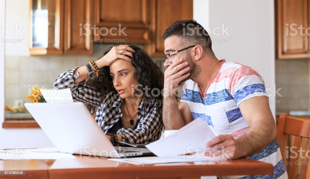 Couple receiving home bills stock photo
