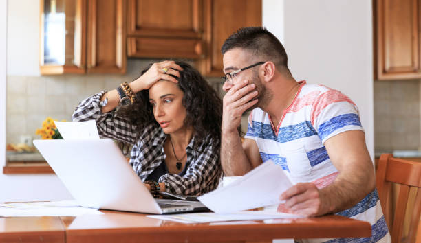 couple receiving home bills - home finances stock pictures, royalty-free photos & images