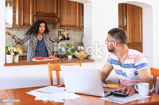 istock Couple receiving home bills 900120060