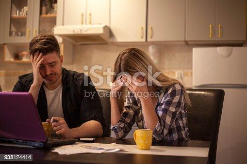 istock Couple receiving home bills. 938124414