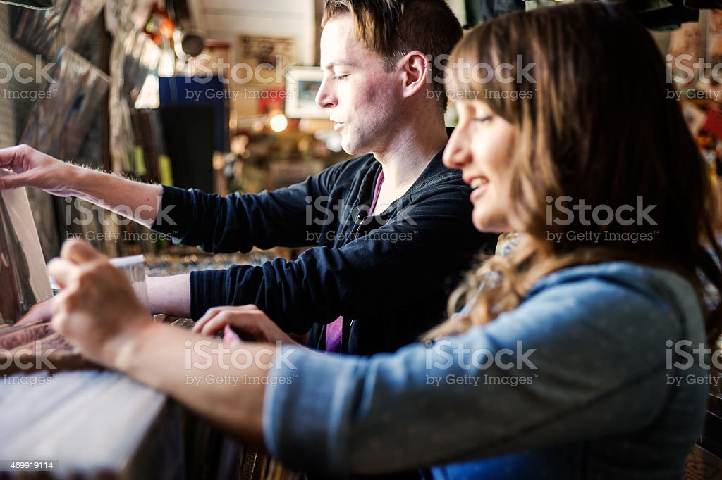 Couple record shopping in an old school store stock photo