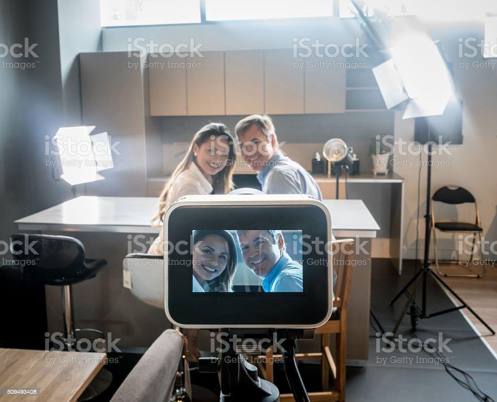 Couple recording a tv commercial stock photo