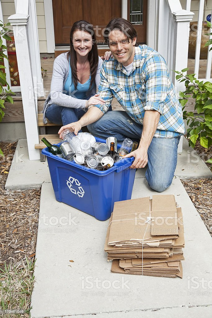 Couple recycling stock photo
