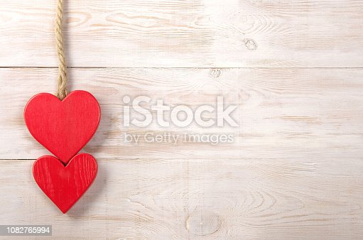 red hearts. valentines day background. old rope