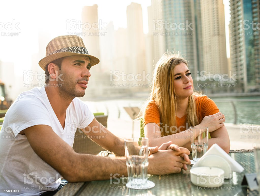 couple refreshment at cafe in dubai marina stock photo