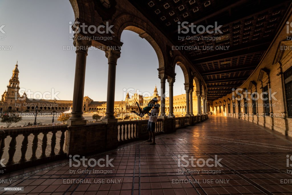 Couple rejoicing in the Plaza de Espana at sunset.  Seville stock photo