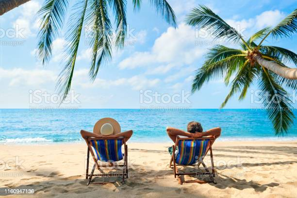 Couple relax on the beach enjoy beautiful sea on the tropical island picture id1160947136?b=1&k=6&m=1160947136&s=612x612&h=dooqnamgdoc0m9lstguivu99wbctyncj7lz2nvufhp4=