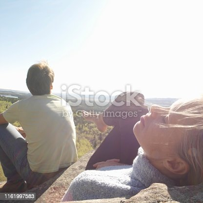 She reclines as he looks onwards