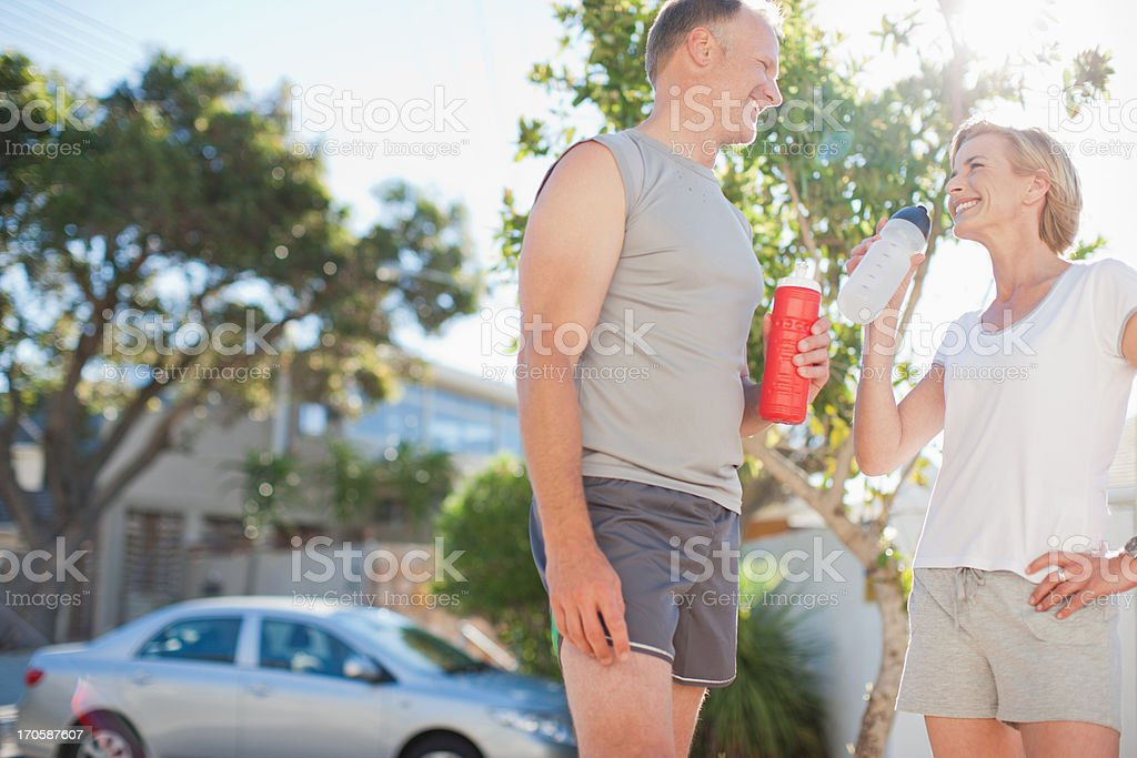 Couple relaxing after exercise royalty-free stock photo