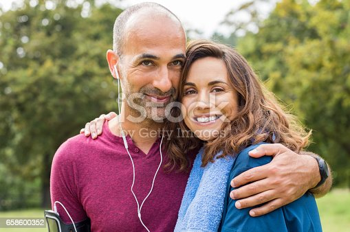 istock Couple relaxing after jogging 658600352