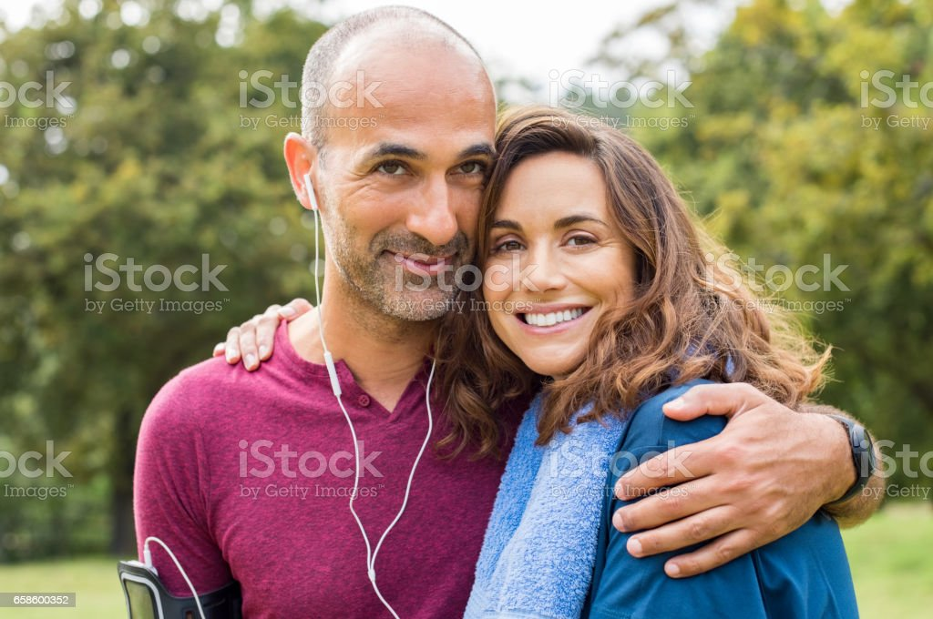 Couple relaxing after jogging stock photo