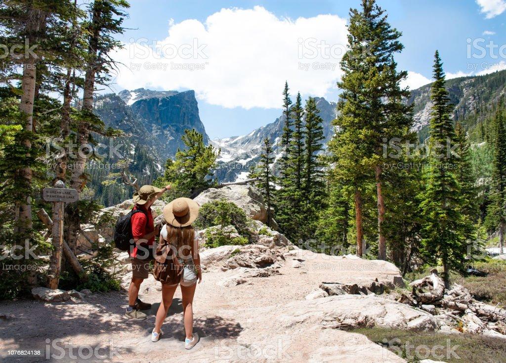 Couple relaxing and enjoying beautiful mountain view in Colorado. stock photo