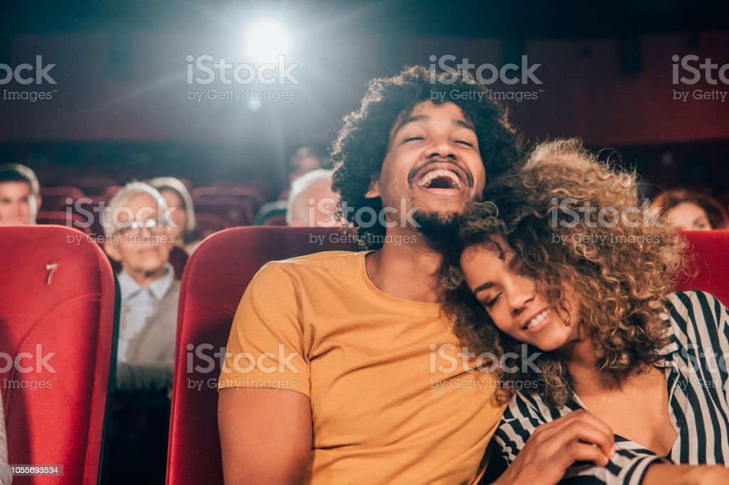 Couple relaxing at cinema stock photo