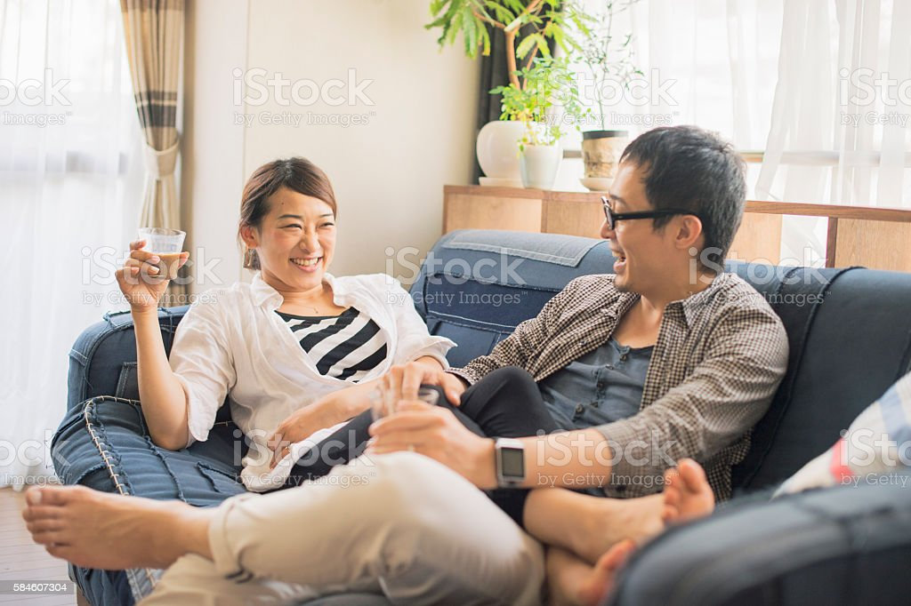 Couple relaxing at home on holiday stock photo