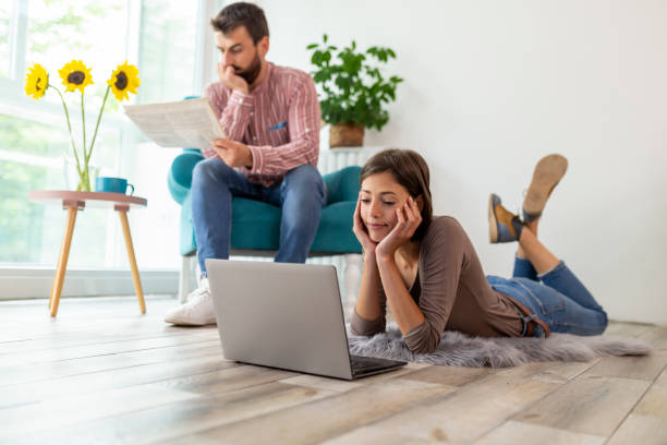 Couple relaxing at home stock photo